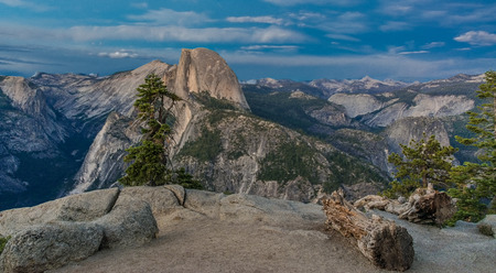 As the sun lowers in the sky the overlook at Half Dome displays a tranquil view.