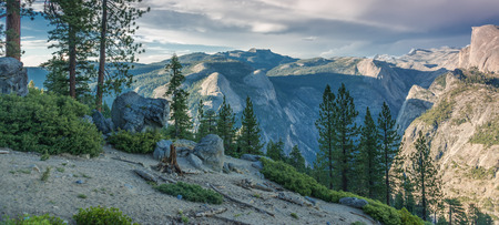 A panoramic view of the mountains near Half Dome, in Yosemite National Park, early evening.