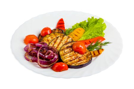 Vegetable salad with grilled eggplant, cherry tomatoes, red and yellow bell peppers, purple onions, dill, lettuce leaf. Barbecued healthy vegetable isolated on white background