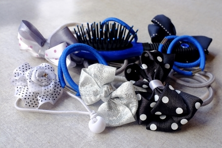 scrunchy: A few elastic hair bands - simple and in the shape of bows and flowers - and a small hair-brush Stock Photo