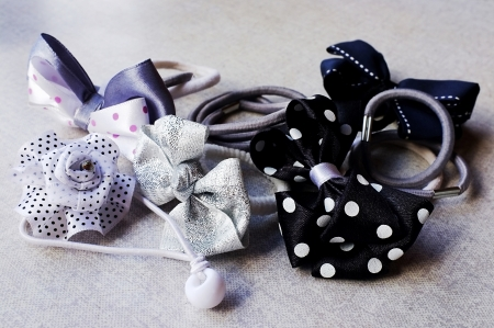 A few elastic hair bands - simple and in the shape of bows and flowers photo