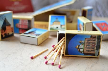 matchbox: Pink-head matches falling out of a souvenir match-box