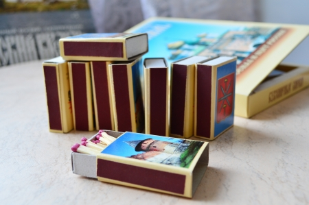 matchbox: Pink-headed matches in a match-box   a set of other souvenir match-boxes in the background