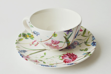 flowery: Flowery teacup and saucer of porcelain