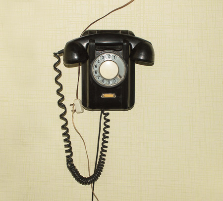 xx century: Old telephone set of 50s of XX century hanging on the wall