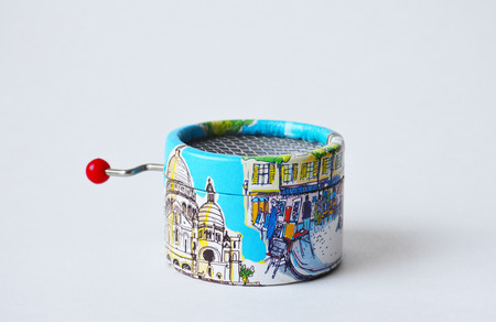Souvenir toy musical-box with views of Paris on its sides