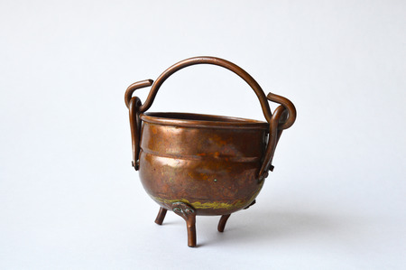 fleamarket: Three-leg copper pot found on a flea-market Stock Photo