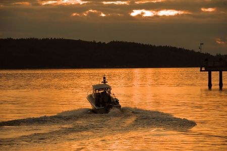 Fishing boat running into the sunset near Seattle