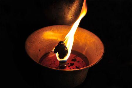 idolatry: Butter lamp burning at the Boudha Buddhist monastery in Kathmandu, Nepal   Stock Photo