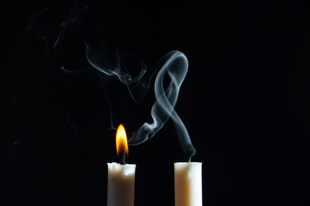 blue romance: Two candle with smoke