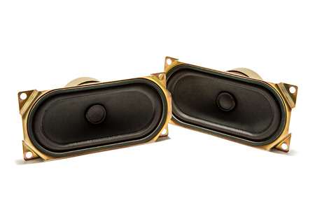loudness: small gold speaker isolated on white background