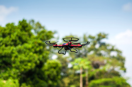 controlled: Remote Controlled Quadcopter Drone Stock Photo