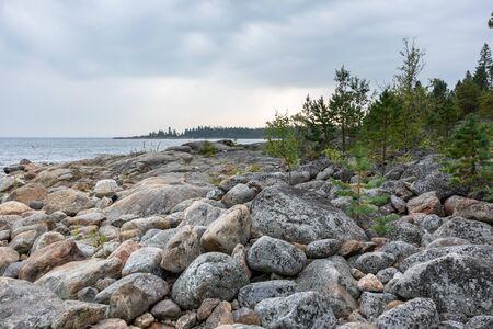 Sweden rocky sea side. Northern epic mystic cloudy grey landscape. Travel scandinavia