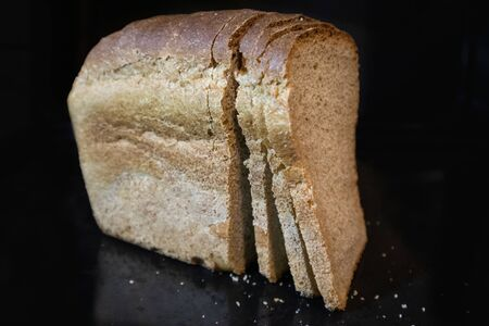 Dark bread food close view healthy wholegrain eat. Big yammy cooking kitchen table view.