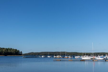 Clear water in lake near harbor with boats port finnish summer landscape