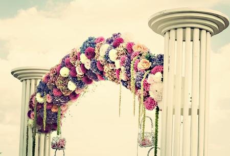 dahlia: Wedding arch with dahlia, cloves and roses Stock Photo