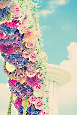 cloves: Flower wedding arch with dahlias, cloves and roses