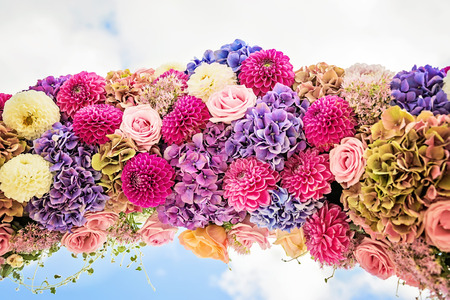 cloves: Flower arch with dahlias, cloves and roses