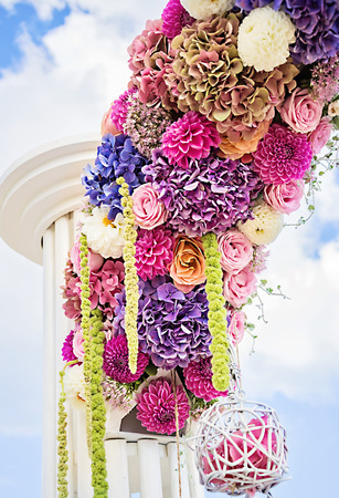 natural arch: Wedding arch with dahlias, cloves and roses Stock Photo
