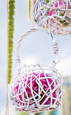 white wood: Small white wood basket on wedding arch
