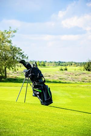 golf bag: Golf bag on the grass Stock Photo