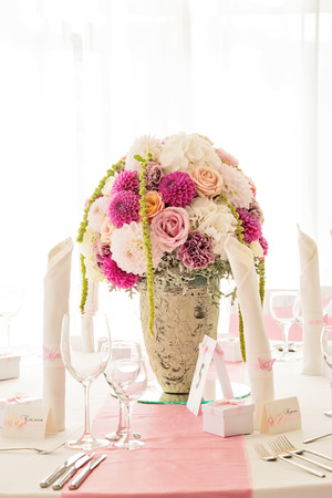 table decoration: Table decoration in white and purple Stock Photo