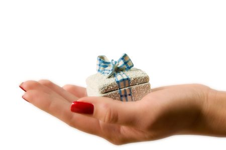 Female hand holding a gift box photo