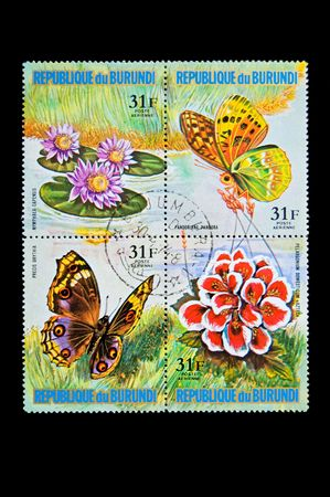 Collection stamps with flowers and butterflies photo