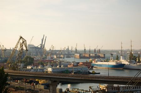 shiprepair: View of ship-repair yard with derricks, cranes, ships, tow boats and barges