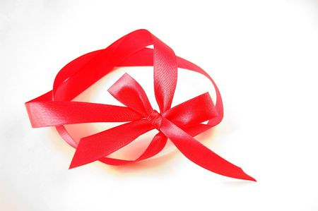 Gift red bow with ribbon isolated on a white background photo