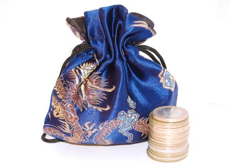change purse: Silky purse and coins isolated on a white background Stock Photo