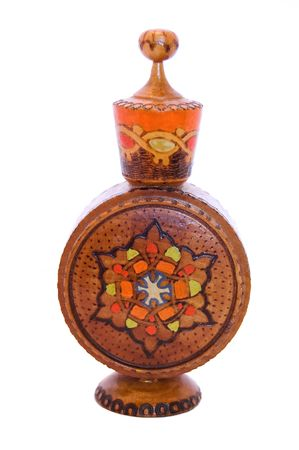 Wooden perfume bottle with ornament photo