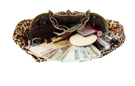 Woman�s handbag with different things that are likely to be found in it photo