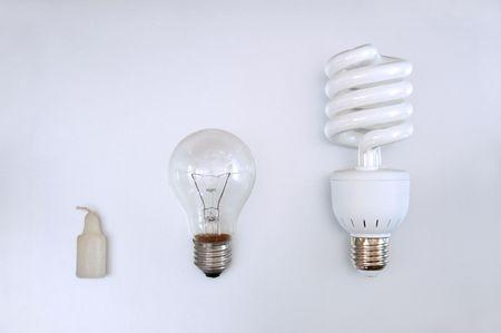 Evolución de la iluminación: vela, la bombilla y la lámpara de ahorro de energía Foto de archivo - 5549925