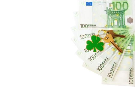 Fan of one hundred euro banknotes with keys and shamrock pendant symbolizing luck and success in business Stock Photo - 5552600