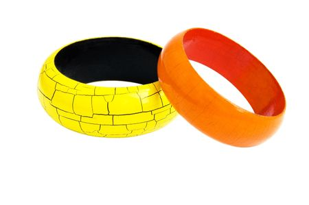 wristbands: Wooden yellow & orange bracelets isolated on a white background
