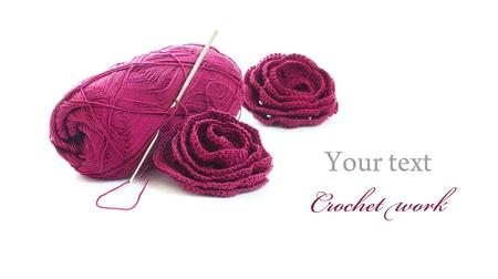 yarn: Crochet work: skein of yarn, crochet hook and crocheted roses: