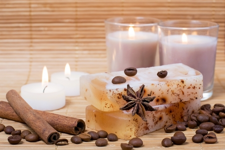 spa candles: Spa setting: natural hand-made soap, cinnamon, coffee beans and candles