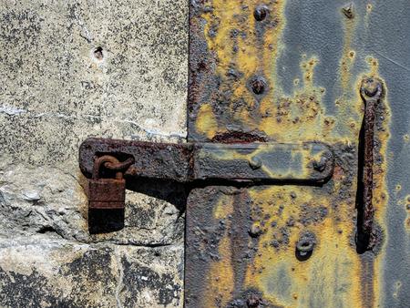 metal door: Antique Metal Door Locking Bracket and Lock Stock Photo