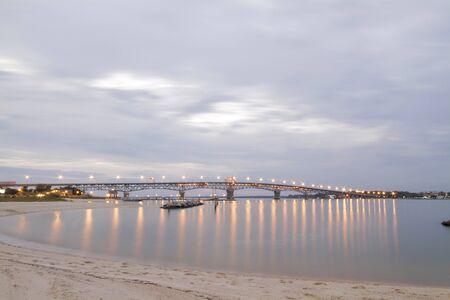 Chesapeake Bay Bridge With Lights Reflecting in Water
