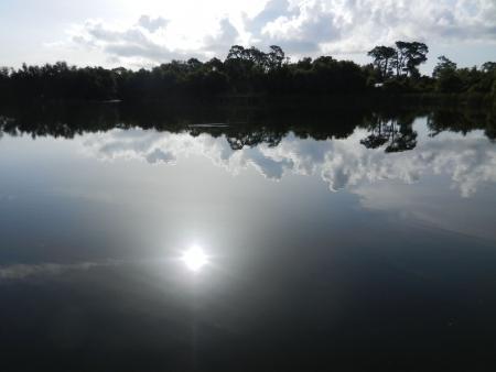 Zon Refection in Lake Stockfoto