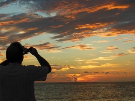 Man Het fotograferen van de Zonsondergang