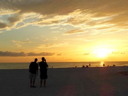 Het fotograferen van de Zon die op strand