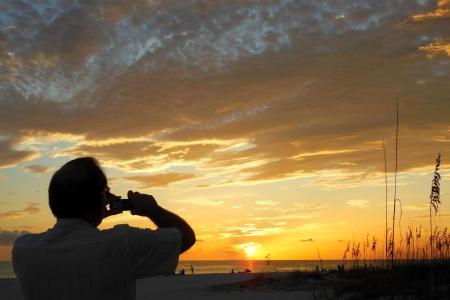 Het vastleggen van de Zonsondergang Stockfoto