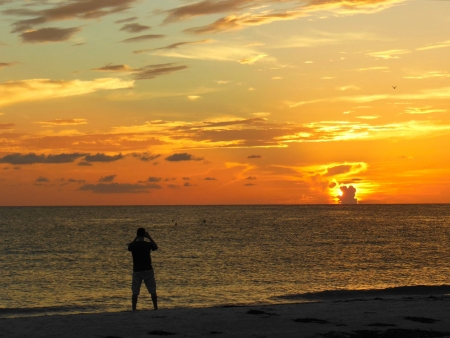 Fotograferen van een zonsondergang op een Florida Beach Stockfoto