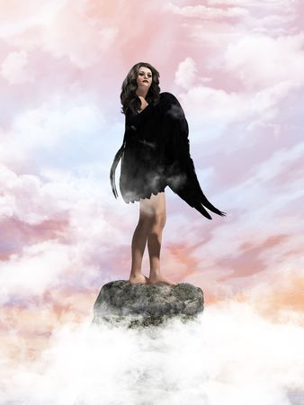 elohim: Angel standing on a rock in the clouds Stock Photo