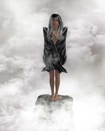 Angel standing on a rock with wings folded on a rock photo