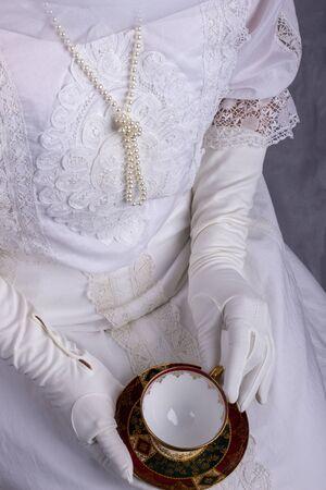 Edwardian woman holding tea cup