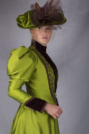 Victorian woman in green outfit