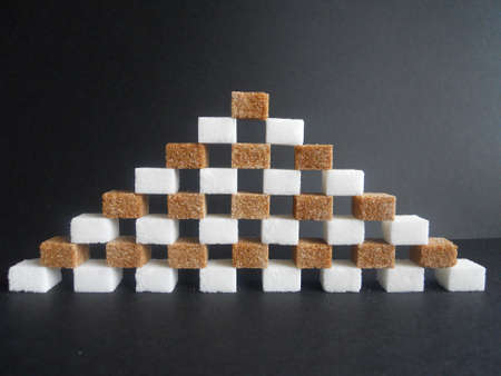 diabetes (white and brown sugar cubes pyramid on black backround) photo